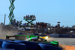 #2 Tequila Patron ESM Nissan DPi, P: Scott Sharp, Ryan Dalziel, Olivier Pla slides wide in turn 1 at the start of the race