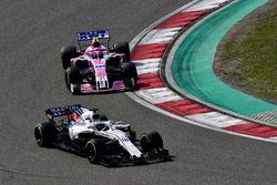 Lance Stroll, Williams FW41 y Esteban Ocon, Force India VJM11