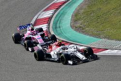 Charles Leclerc, Sauber C37 and Esteban Ocon, Force India VJM11