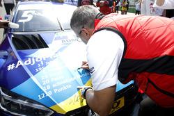 Dieter Gass, Head of DTM Audi Sport signs the car of Mattias Ekström, Audi Sport Team Abt Sportsline