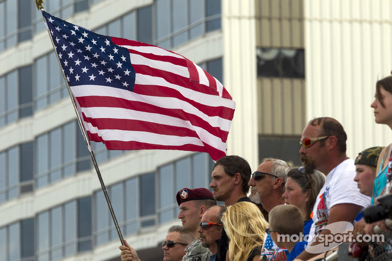 A soldier waves the American flag