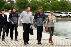 Eric Boullier, McLaren Racing Director with Jenson Button, McLaren and his girlfriend Jessica Michibata