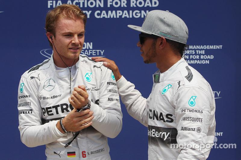 (L to R): Nico Rosberg, Mercedes AMG F1 celebrates his pole position with team mate Lewis Hamilton,