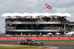 Lewis Hamilton, Mercedes AMG F1 W05 leads Jenson Button, McLaren MP4-29