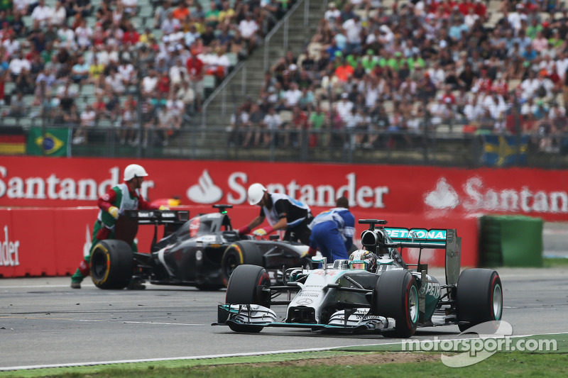 Lewis Hamilton passes Adrian Sutil, who spun and retired from the race