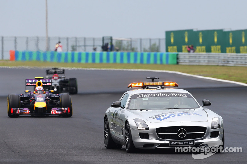Daniel Ricciardo, Red Bull Racing RB10 leads behind the FIA Safety Car