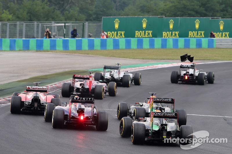 Sergio Perez, Sahara Force India; Sebastian Vettel, Red Bull Racing