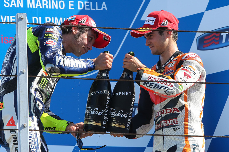 Podium: race winner Valentino Rossi, third place Dani Pedrosa