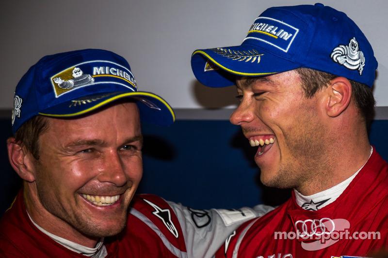 LMP1 winners Marcel Fässler and Andre Lotterer celebrate
