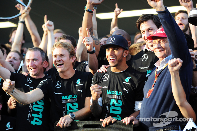 (L to R): Paddy Lowe, Mercedes AMG F1 Executive Director, Mercedes AMG F1; Lewis Hamilton, Mercedes AMG F1; Toto Wolff, Mercedes AMG F1 Shareholder and Executive Director; and Niki Lauda, Mercedes Non-Executive Chairman celebrate winning the 2014 Construc