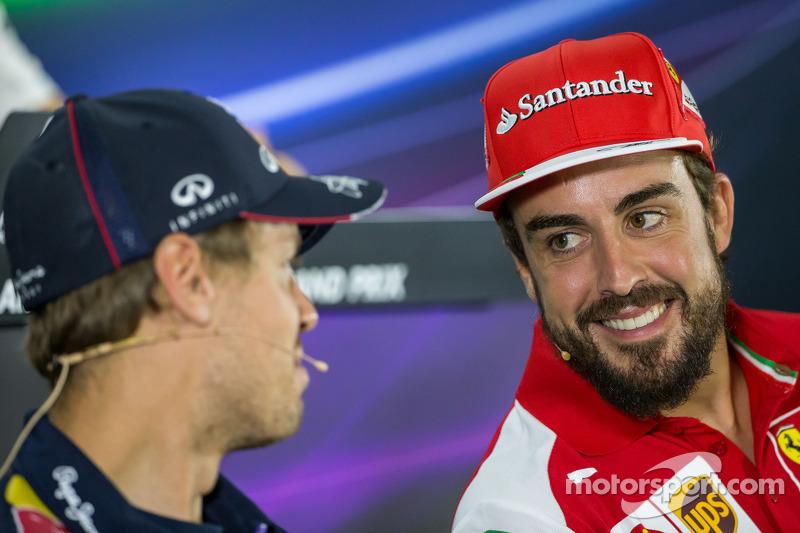 (L to R): Sebastian Vettel, Red Bull Racing with Fernando Alonso, Ferrari in the FIA Press Conference