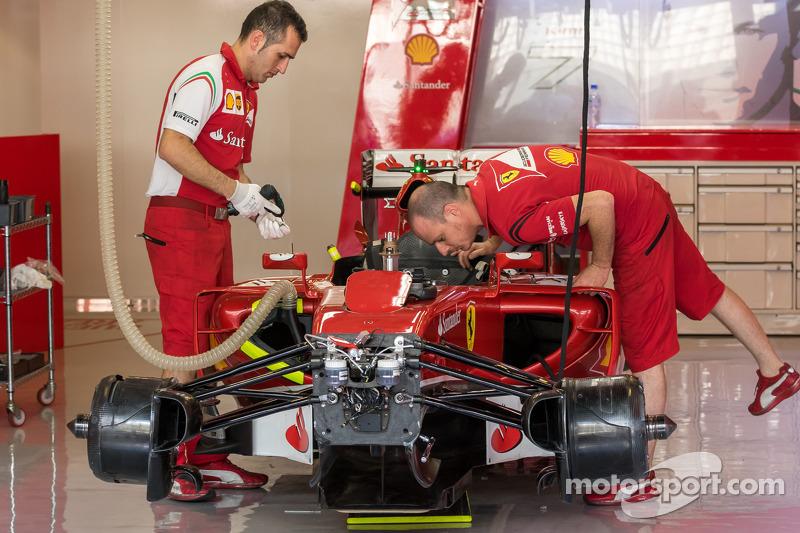 A Ferrari F14-T is prepared in the pits
