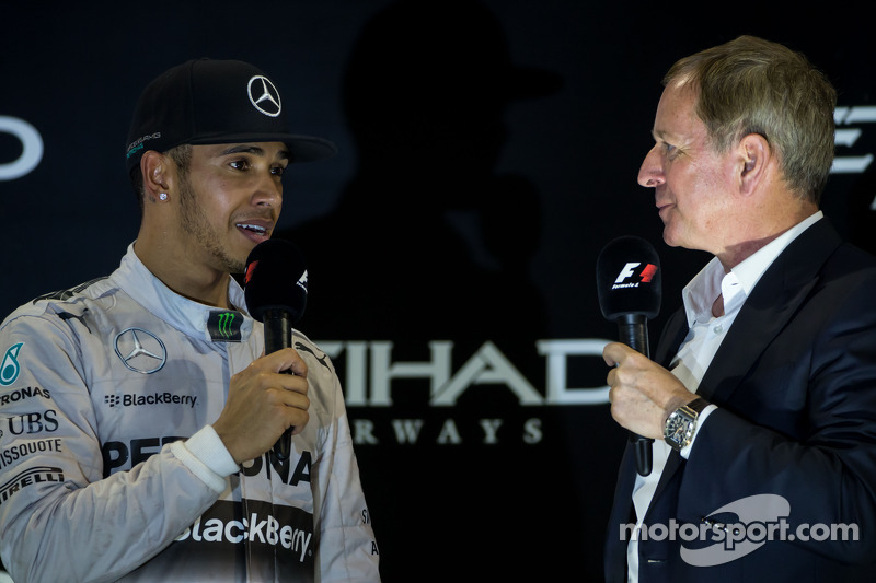 (L to R): Race winner and World Champion Lewis Hamilton, Mercedes AMG F1 on the podium with Martin Brundle, Sky Sports Commentator