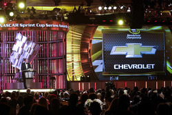 General Motors Executive Vice President Product Development Purchasing and Supply Chain Mark Reuss accepts the 2014 NASCAR Sprint Cup Manufacturers Championship trophy