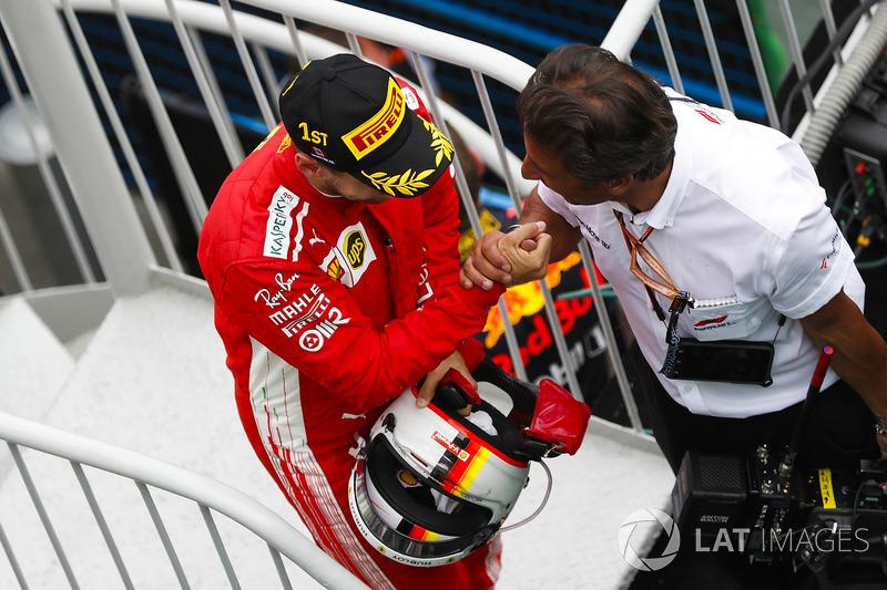 Sebastian Vettel, Ferrari, 1st position, celebrates on his way to the podium