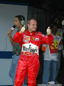 Pole winner Rubens Barrichello celebrates