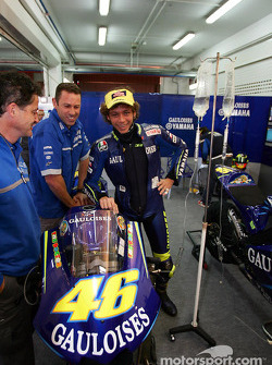 Doctor Rossi monitors IV shots to his bike