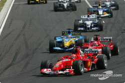 First corner: Michael Schumacher leads Rubens Barrichello and Fernando Alonso