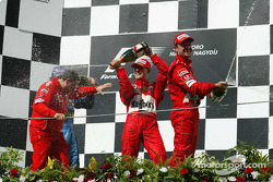 Podium: champagne for Jean Todt, Fernando Alonso, Michael Schumacher and Rubens Barrichello