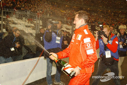 The World Champions Challenge 2004 winner Michael Schumacher sprays champagne
