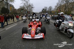 Parade on Champs-Elysées: Michael Schumacher drives his Ferrari F2004 F1 on the famous avenue in Paris
