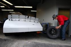 Richard Petty checks a tire