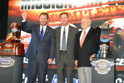 Ediie Gossage celebrates the second Nextel Cup race at Texas Motor Speedway with Brian France and Bruton Smith