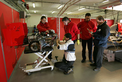 BCN Competicion team members work on the GP2 car