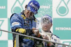 Podium: champagne for race winner Fernando Alonso