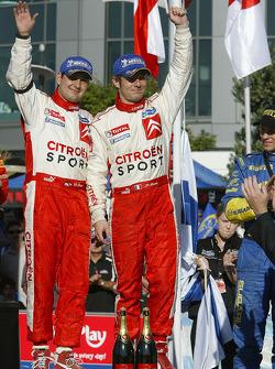 Podium: rally winners Sébastien Loeb and Daniel Elena celebrate