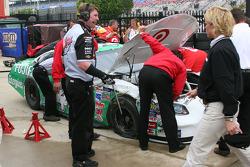 Work on Casey Mears' damaged car