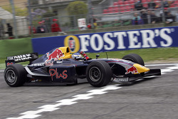 Heikki Kovalainen takes the checkered flag