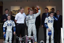 Podium: race winner Kimi Raikkonen with Nick Heidfeld and Mark Webber
