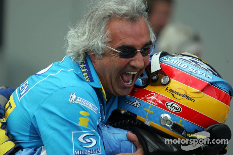 Race winner Fernando Alonso celebrates with Flavio Briatore