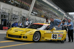 Max Papis with Corvette Racing team members back from scrutineering
