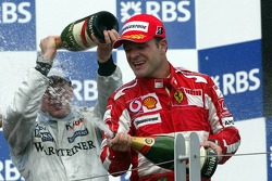 Podium: champagne for Kimi Raikkonen and Rubens Barrichello