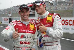 Pole winner Tom Kristensen celebrates with Martin Tomczyk