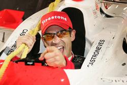 Race winner Helio Castroneves celebrates