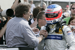 Race winner Gary Paffett celebrates with Norbert Haug