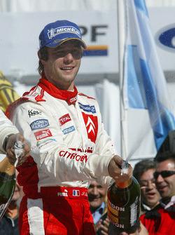 Podium: race winner Sébastien Loeb celebrates