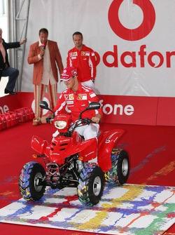 Vodafone event at Hockenheim Talhaus: Michael Schumacher paints with a quad bike