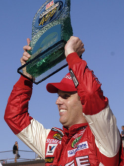 Victory lane: race winner Jeremy Mayfield celebrates
