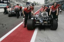 Kimi Raikkonen and Juan Pablo Montoya pushed back