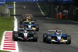 Jacques Villeneuve and Kimi Raikkonen battle