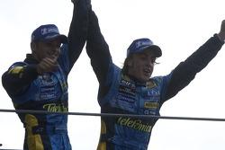 Podium: Giancarlo Fisichella and Fernando Alonso celebrate