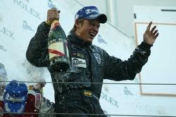 Podium: champagne for Tom Chilton