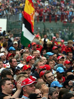 Fans wait for the podium ceremony