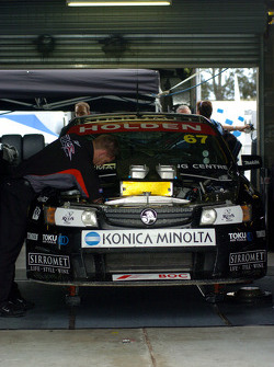 Crew work on the Morris/Radisich car