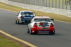 Lee Holdsworth follows Alain Menu along the back straight
