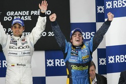 Podium: race winner Juan Pablo Montoya and 2005 World Champion Fernando Alonso celebrate